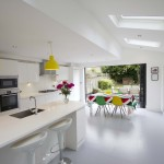 Open plan kitchen/dining room in white with skylight