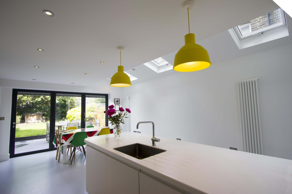 Open plan kitchen/dining room in white with skylight - reverse angle